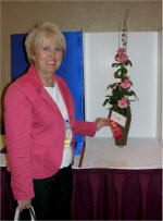 Kathy Dodson with arrangement